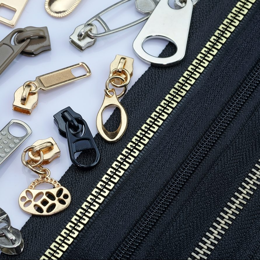 stock-photo-zipper-on-a-black-fabric-base-with-different-color-runners-different-types-of-metal-zipper-slider-1834339153
